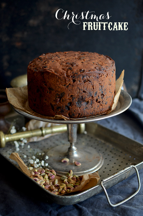 Traditional maturing Christmas fruit cake with pistachios and apricots