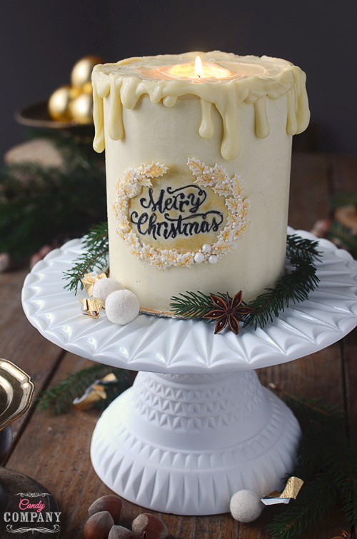 Bake yourself a Christmas candle cake, decoration and a dessert in one! Cranberry Gingerbread cake and white chocolate ganache just delicious