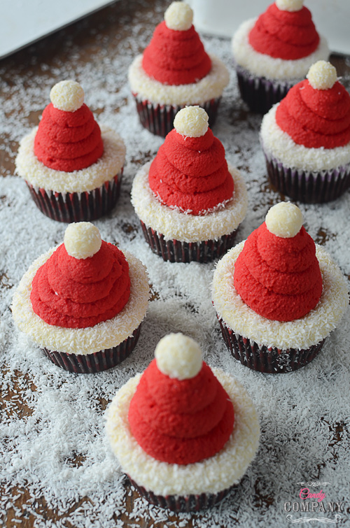 Santa Hat cupcakes. Moist chocolate cupcake with coconut filling and coconut flavored whipped cream.