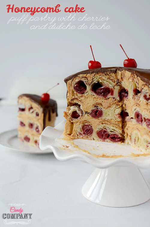 Honeycomb cake made from puff pastry with cherries and dulche de leche frosting and chocolate glaze