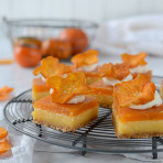 Best lemon bars ever, on grahan crust with creamy lemon curd layer and persimmon mousse. Decorated with whipped cream and dried persimmons
