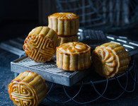Traditional Chinese moon cake with red bean paste filling and almond cocoa filling