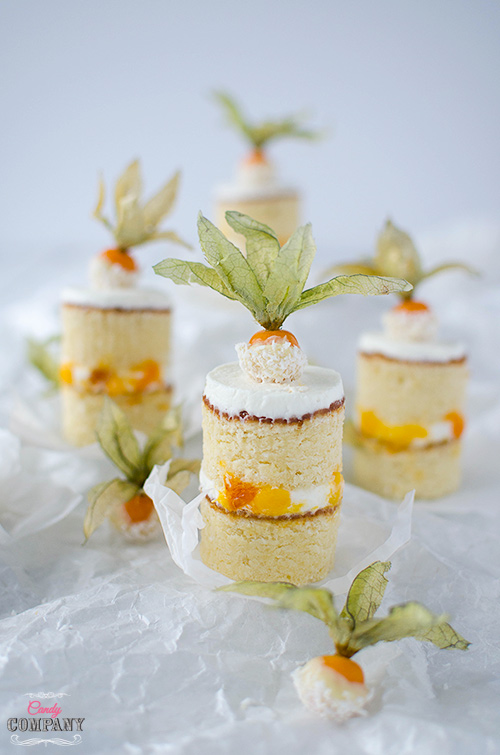 Exotic mini coconut cake with mango and persimmon filling