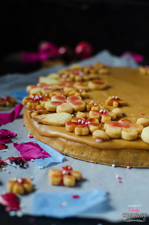 Caramelized white chocolate tart with sloe gin roasted plums