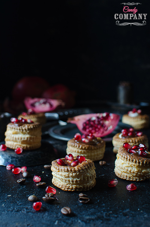 Puff pastry coffee cups with coffee caramel sauce and pomegranate seeds