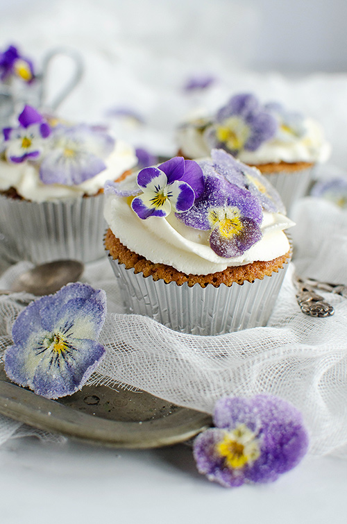 Rhubarb rosewater cupcakes with sugared flowers decoration