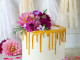 Glamour gold drip birthday cake with fresh flowers arangement