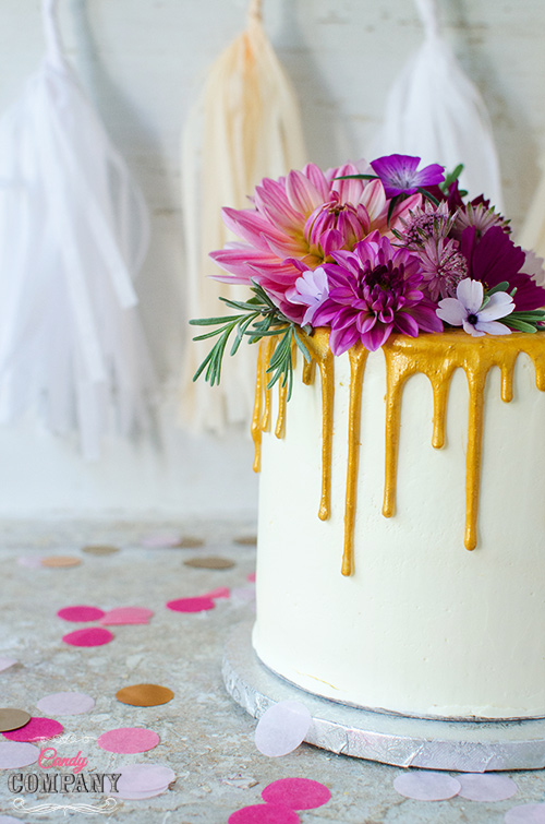 Glamour gold drip birthday cake with fresh flowers arangement