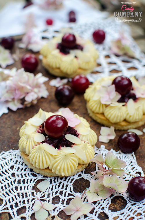 Almond cherry tarts with cardamon and orange blossom water creme patisserie