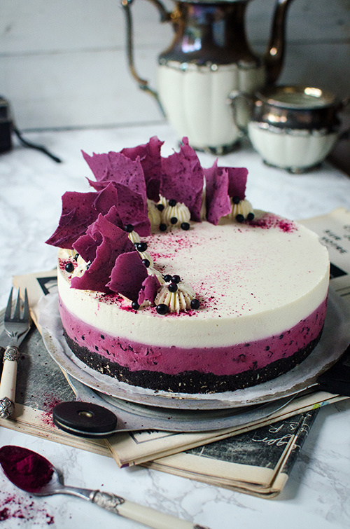 Delicious and easy recipe for no bake elderberry coconut mousse cake on oreo crust and chocolate shatds deocration. Food photography by Candy Company