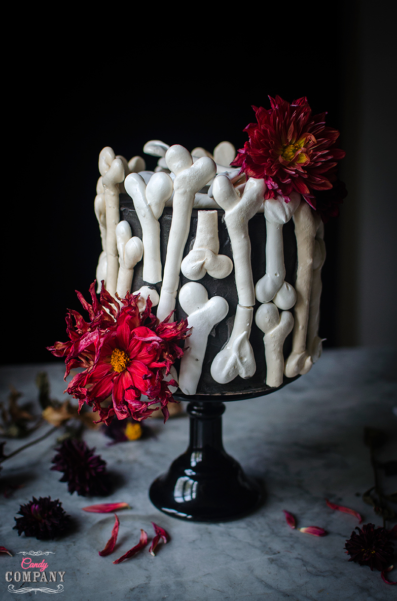 Meringue bone Halloween cake. Chestnut mousse and raspberry and rose petal jam mousse cake. Food photography by Candy Company