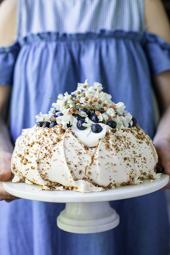 hazelnut praline, blueberry and false acacia tree flower pavlova recipe. Food photography by Candy Company